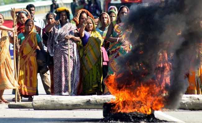 Members of Bengali community burn tyres to block a road during \'Bandh\' over the killing of five people by suspected United Liberation Front of Assam (ULFA) last night, at Tinsukia district of Assam, Friday, Nov 02, 2018. (PTI Photo)
