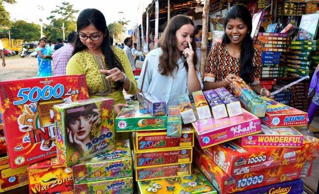 Women buy firecrackers for the festival of Diwali, in Chennai, Sunday, November 4, 2018. (PTI Photo)