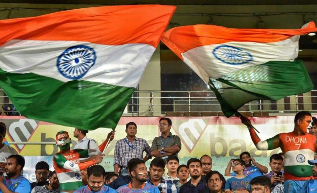 Indian suporters wave tri-colours during the 1st T20I match against West Indies at Eden Garden in Kolkata, Sunday, Nov 4, 2018. (PTI Photo/Ashok Bhaumik)