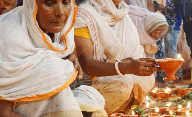 Widows of Vrindavan celebrate Diwali at Gopinath Temple in Vrindavan, Sunday, Nov 4, 2018. (PTI Photo)