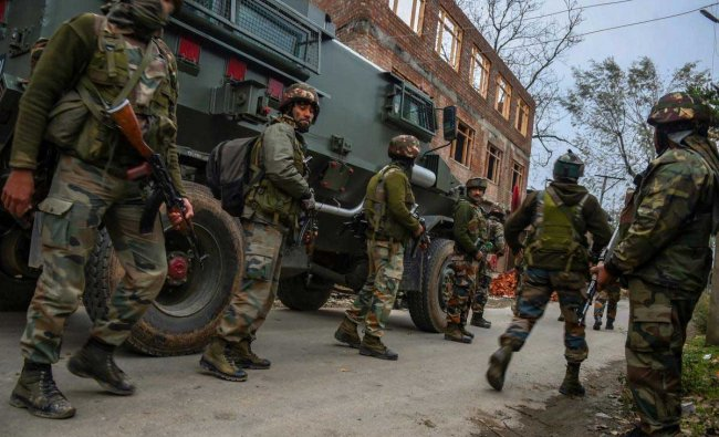 Army soldiers during cordon and search operation at Bakoora on the outskirts of Srinagar, on Monday, November 5, 2018. According to police, a cordon and search operation was launched after they received specific information about the presence of terrorists in Bakoora village, following which the militants opened fire. PTI Photo