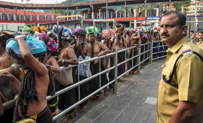 Devotees arrive at Sabarimala Temple, in Pathanamthitta District, Monday, Nov 05, 2018. This is the second time the hill temple will open for \'darshan\' after the Supreme Court allowed entry of women of all age groups into it. (PTI Photo)