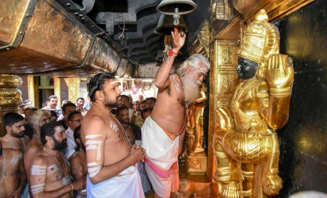 Temple priests offer prayers at Sabarimala Temple, Monday, Nov 05, 2018. This is the second time the hill temple opened for \'darshan\' after the Supreme Court allowed entry of women of all age groups into it. (PTI Photo)
