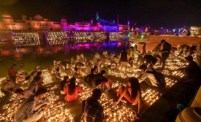 People light earthen lamps on the banks of River Saryu during Deepotsav (grand Diwali celebrations) in Ayodhya, Tuesday, Nov 6 2018. PTI Photo