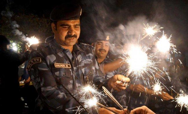RAF (Rapid Action Force) jawans celebrating Diwali festival in Jabalpur on Tuesday night, Nov, 06 2018, (PTI Photo )