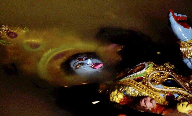 Devotees immerse an idol of Goddess Kali at River Ganga in Kolkata on Wednesday.Nove 07,2018 PTI Photo