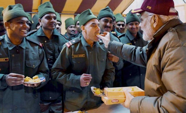 Prime Minister Narendra Modi celebrating Diwali with the jawans of the Indian Army and ITBP, at Harsil, in Uttarakhand on Wednesday, Nov. 07, 2018. (PIB Photo via PTI)