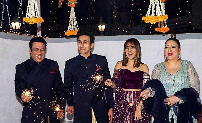 Bollywood actor Govinda with his son Yashvardan, daughter Tina and wife Sunita Ahuja during the Diwali celebrations 2018 in Mumbai, Wednesday, November 7, 2018. (PTI Photo)