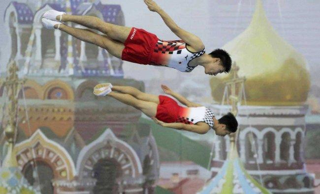 Yasuhiro Ueyama and Ryosuke Sakai of Japan perform on the trampoline during the men\'s synchronised trampoline qualifications of the 33rd Trampoline Gymnastics World Championships in St.Petersburg, Russia, Thursday, Nov. 8, 2018. AP/PTI