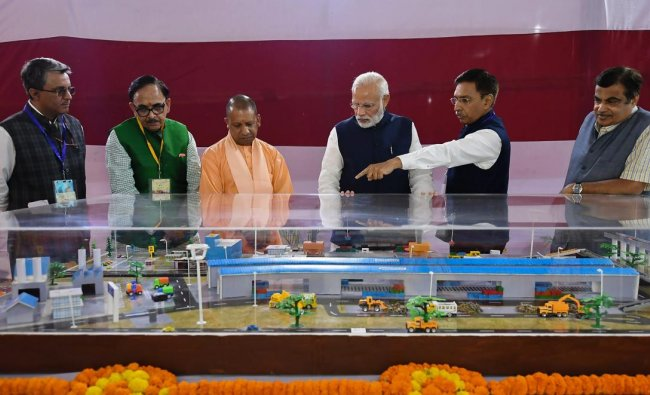 The Prime Minister, Shri Narendra Modi at the dedication of the India's First Multi-Modal Terminal on river Ganga to the Nation, in Varanasi, Uttar Pradesh on November 12, 2018. The Union Minister for Road Transport & Highways, Shipping and Water Resources, River Development & Ganga Rejuvenation, Shri Nitin Gadkari, the Chief Minister of Uttar Pradesh, Yogi Adityanath and the Secretary, Ministry of Shipping, Shri Gopal Krishna are also seen.