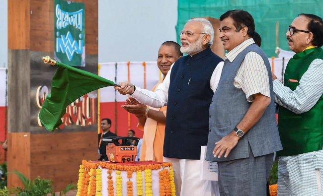 Prime Minister Narendra Modi inaugurates India\'s first multi-modal terminal on the Ganga river, in Varanasi, Monday, Nov 12, 2018. Also seen are Union Transport Minister Nitin Gadkari, Uttar Pradesh Chief Minister Yogi Adityanath and UP BJP chief Mahendra Nath Pandey. (PIB Photo via PTI)