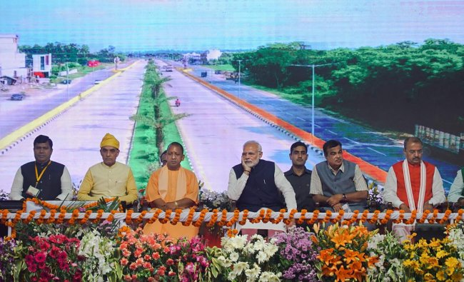 Prime Minister Narendra Modi with Union Transport Minister Nitin Gadkari, Uttar Pradesh Chief Minister Yogi Adityanath and other dignitaries during the inauguration of two major national highways and an inland waterways project, in Varanasi, Monday, Nov 12, 2018. (PTI Photo)