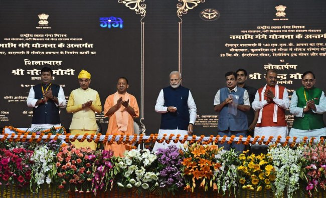 Prime Minister Narendra Modi inaugurates two major national highways and an inland waterways project, in Varanasi, Monday, Nov 12, 2018. Also seen are Union Transport Minister Nitin Gadkari and Uttar Pradesh Chief Minister Yogi Adityanath among others. (PTI Photo)