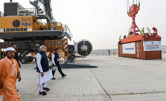 Prime Minister Narendra Modi looks on at India\'s first multi-modal terminal on the Ganga river during its inaugural function, in Varanasi, Monday, Nov 12, 2018. (PIB Photo via PTI)