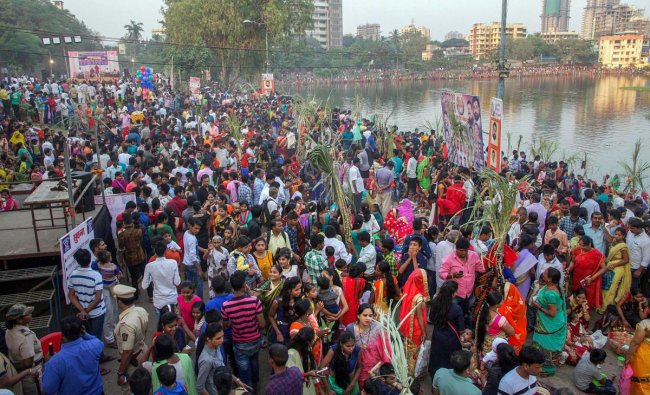 Devotees offer prayers to the Sun god during Chhath Puja in Thane, Tuesday, Nov 13, 2018. (PTI Photo)