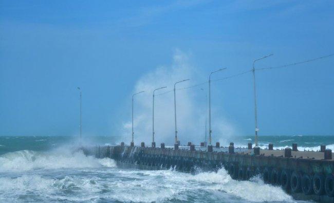 A wave hits the sea walkway after cyclonic storm \'Gaja\' made landfall at Rameswaram, in Ramanathapuram district. PTI photo