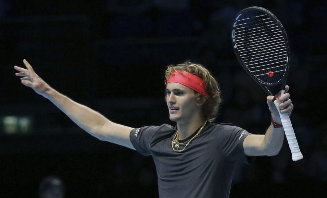 Alexander Zverev of Germany celebrates winning match point against John Isner of the United States in their ATP World Tour Finals singles tennis match at the O2 Arena in London. AP/PTI photo