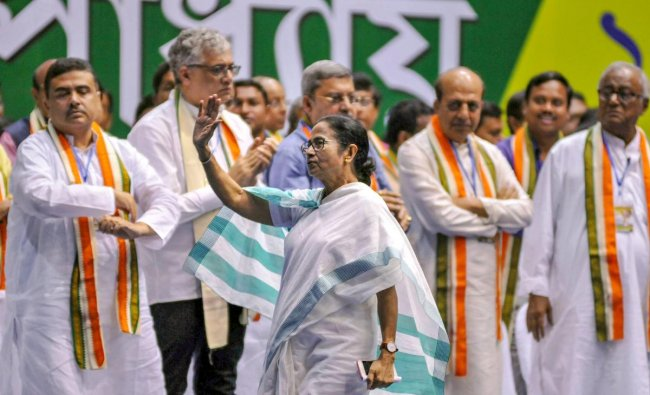 Trinamool Congress supremo and West Bengal Chief Minister Mamata Banerjee waves at party workers during an extended General Council Meeting, in Kolkata. PTI photo
