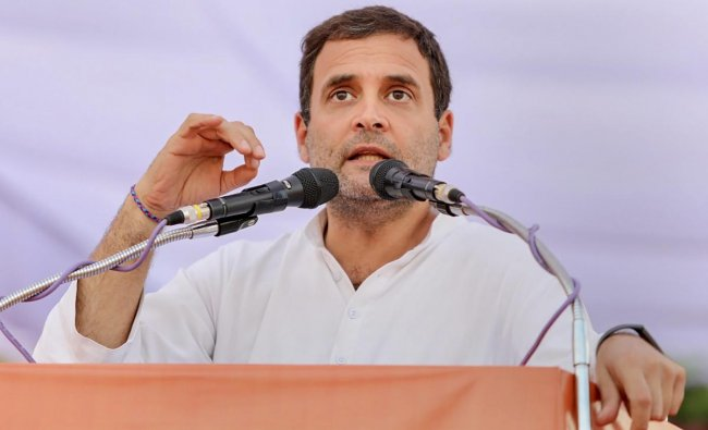Congress President Rahul Gandhi addresses a public rally at Mahatma Gandhi Stadium Ground ahead of the State Assembly elections in Mandla district. PTI photo