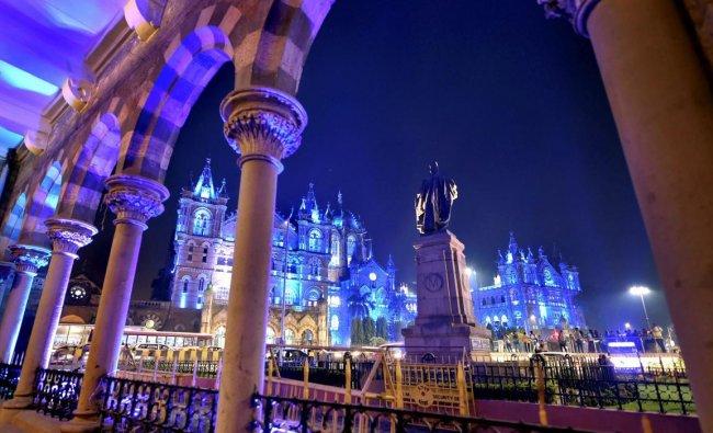 A view of illuminated Chhatrapati Shivaji Maharaj Terminus (CSMT) and Brihanmumbai Municipal Corporation (BMC) building to mark World Children\'s Day 2018, in Mumbai. PTI Photo