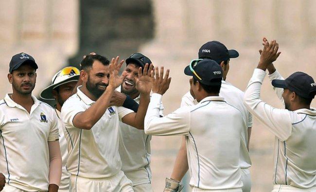 Bengal bowler Mohammad Shami celebrates with teammates after dismissing Kerala batsman KB Arun Karthik (not seen) during Ranji Trophy match, at Eden Garden in Kolkata. PTI Photo