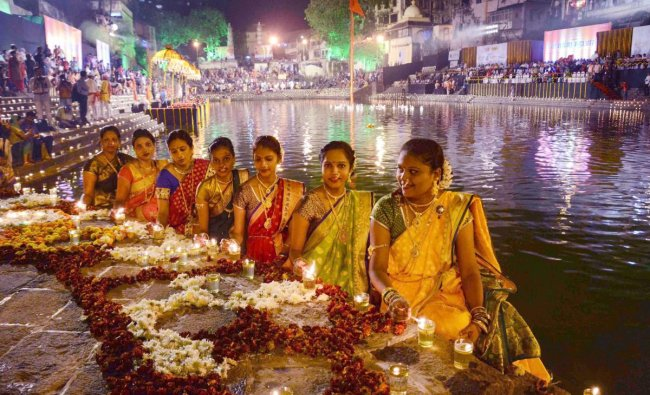 Hindu women light lamps at Banganga on the eve of Kartik Purnima, in Mumbai. PTI photo