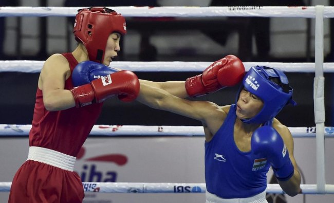 India's Mary Kom exchanges punches with Hyang Kim of Peoples Republic of Korea in 45-48kg category during the AIBA Women\'s World Boxing Championships, in New Delhi. PTI photo