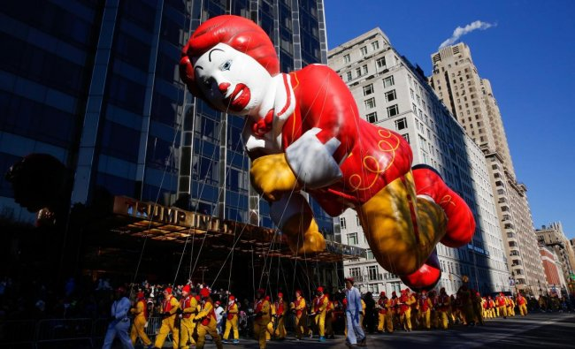 The Ronald McDonald balloon passes by windows of a building on Central Park West during the 92nd annual Macy\'s Thanksgiving Day Parade in New York. AP/ PTI photo