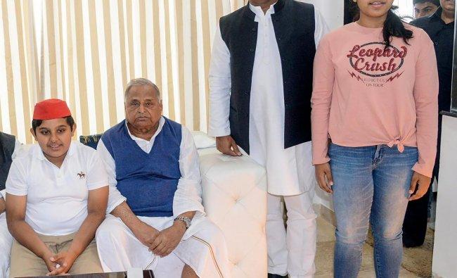 Samajwadi Party founder Mulayam Singh Yadav and Samajwadi Party Chief Akhilesh Yadav with other family members on Mulayam Singh\'s 80th birthday celebrations, in Lucknow. PTI photo