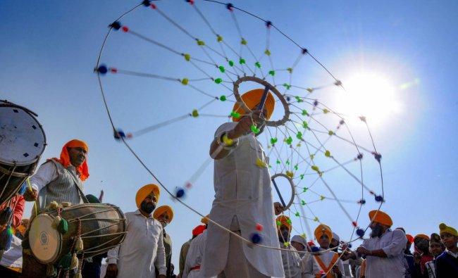 Sikh youth performs martial arts \'Gatka\' during a procession at Sri Harmandir Sahib (Golden Temple) on the eve of 550th birth anniversary of Guru Nanak Dev Ji, in Amritsar. PTI photo