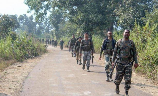 Latehar: CRPF and Jharkhand police personnel patrol at a village during an anti-Naxal operation at Garu in Latehar, Jharkhand, Tuesday, Nov 27, 2018. (PTI Photo)