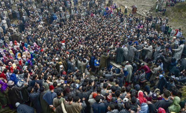 Tral: Villagers attend the funeral of one of the militants who belonged to the Ansar Ghazwatul Hind, an ISIS offshoot at Reshi Pora village, Tral of Pulwama District, Tuesday, Nov.27, 2018. Three militants, including one from an ISIS offshoot, and a soldier were killed while two jawans suffered injuries in two separate encounters in Jammu and Kashmir\'s Kulgam and Pulwama districts. (PTI Photo/S Irfan)