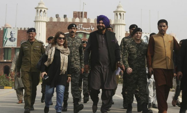 Wagha : Former Indian cricketer-turned-politician Navjot Singh Sidhu, center, arrives at the Pakistani border post Wagha near Lahore, Pakistan, Tuesday, Nov. 27, 2018. Sidhu led his country\'s delegation to Pakistan for the groundbreaking ceremony of Kartarpur corridor on Wednesday, to give access to Indian Sikh pilgrims to visit the shrine of their spiritual leader Guru Nanak Dev in Pakistan. AP/PTI Photo