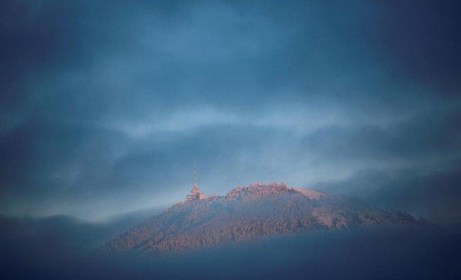 The Gaisberg mountain is seen between the clouds near Salzburg, Austria November 28, 2018. REUTERS/Leonhard Foeger