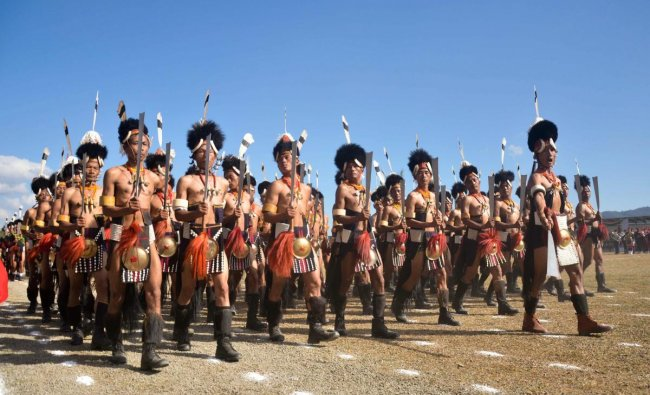 Contingents of Nagaland Village Guard march during the 55th Nagaland Statehood Day celebration in Kohima. (PTI Photo)