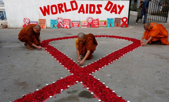 Buddhist monks light candles during an HIV/AIDS awareness campaign on the occasion of World AIDS Day in Kolkata. (Reuters Photo)