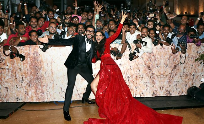 Ranveer Singh and Deepika Padukone pose for a photograph during their wedding reception party in Mumbai. (PTI Photo)