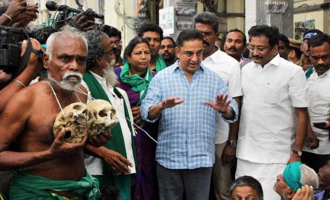 Actor and Makkal Needhi Maiam President Kamal Hassan interacts with farmers on their return from New Delhi after participating in farmers\' protests, at the Egmore Railway Station in Chennai. (PTI Photo)