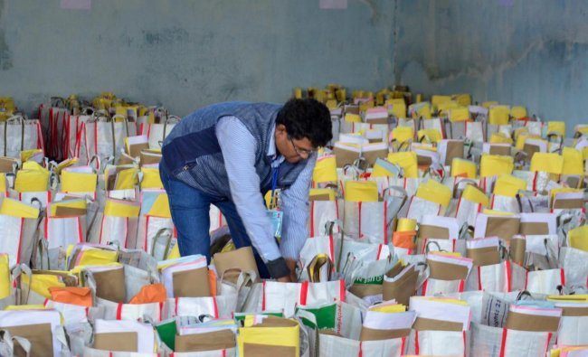 An election official prepares the electoral material for the first phase of Assam Panchayat elections at Amingaon in Kamrup (Rural) district. (PTI Photo)