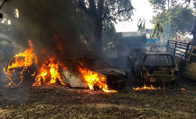 Vehicles set on fire by a mob during a protest over the alleged illegal slaughter of cattle, in Bulandshahr, Uttar Pradesh. (PTI Photo)