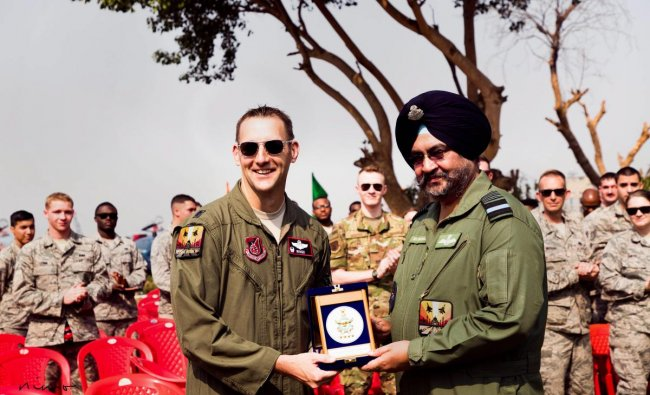 Chief of the Air Staff Air Chief Marshal BS Dhanoa presents a memento to a US Air Force contingent member participating in Ex Cope India 2018, at Air Force Station, Kalaikunda, West Bengal. (PTI Photo)