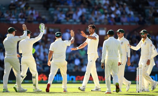 Mitchell Starc celebrates after taking a wicket during day one of the first test match between Australia and India at the Adelaide Oval in Adelaide, Australia. (Reuters Photo)