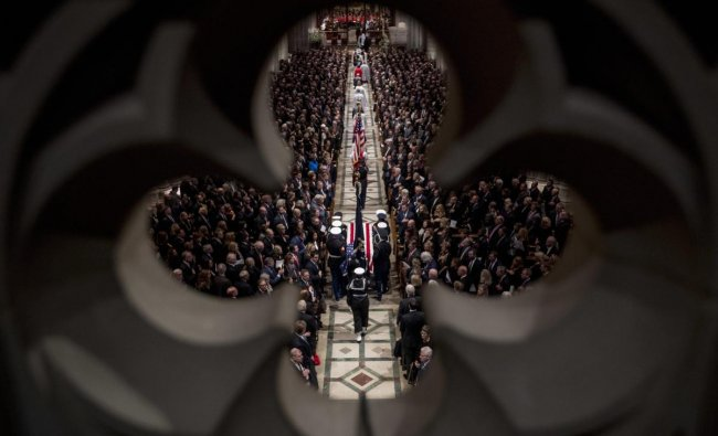 The flag-draped casket of former President George H.W. Bush is carried by a military honor guard into a State Funeral at the National Cathedral in Washington. (AP/PTI Photo)