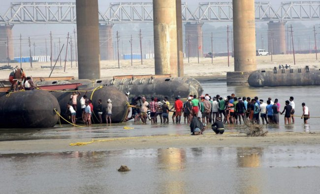 Labourers building a pontoon bridge, ahead of Kumbh Mela 2019 on river Ganga, in Allahabad. (PTI Photo)
