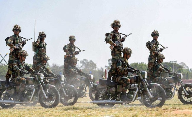 A motocycle team \'Tornadoes\' of Army Service Corps displays skills during the celebration of 258th anniversary of Army Service Corps (ASC), in Bengaluru, Sunday, Dec. 9, 2018. (PTI Photo)