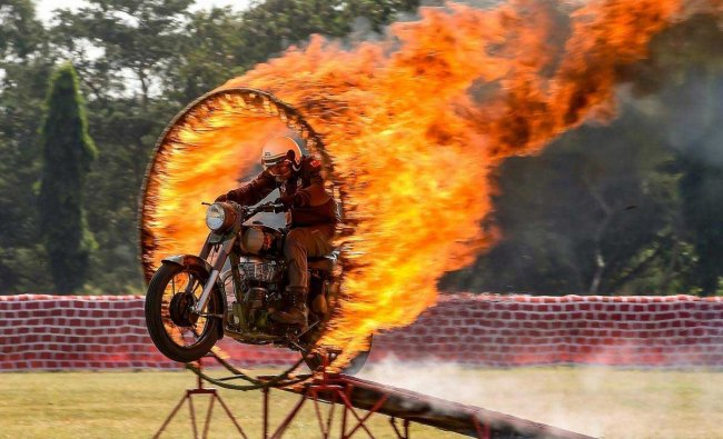 A member of motocycle team \'Tornadoes\' of Army Service Corps displays skills during the celebration of 258th anniversary of Army Service Corps (ASC), in Bengaluru, Sunday, Dec. 9, 2018. (PTI Photo)