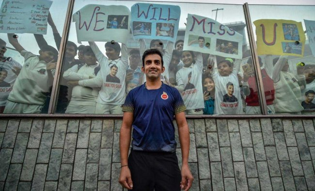 Cricketer Gautam Gambhir poses for photos with his fans on the last day of Ranji Trophy group league match between Delhi and Andhra at Feroz Shah Kotla Ground, in New Delhi, Sunday, Dec. 9, 2018. Gambhir announced retirement from all forms of cricket on Tuesday. (PTI Photo/Arun Sharma)
