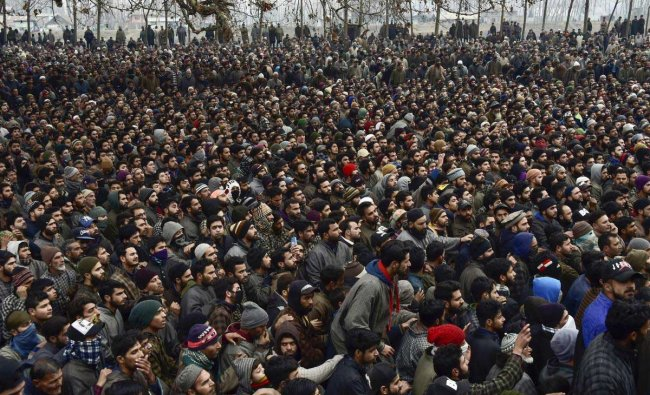 Villagers gather for the joint funeral prayers of Lashkar-e-Toiba (LeT) militants Saqib Bilal Sheikh (17) and Mudasir Rashid Parray (14) at Hajin of Bandipora district, Kashmir, Monday, Dec. 10, 2018. Three LeT militants were killed in a gun battle with security forces on Sunday. ( PTI Photo)