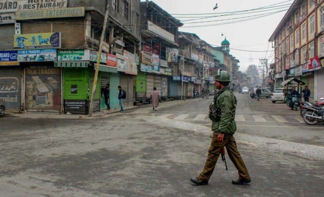 A security personnel patrols across a street during a strike call given by joint Hurriyat leadership on Human Rights Day, in Srinagar, Monday, Dec. 10, 2018. (PTI Photo)