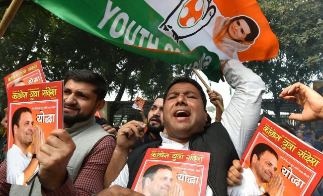Congress party workers celebrate the party\'s good show in the Assembly elections of Rajasthan, Chhattisgarh and Madhya Pradesh, at AICC headquarters in New Delhi, Tuesday, Dec 11, 2018. (PTI Photo)